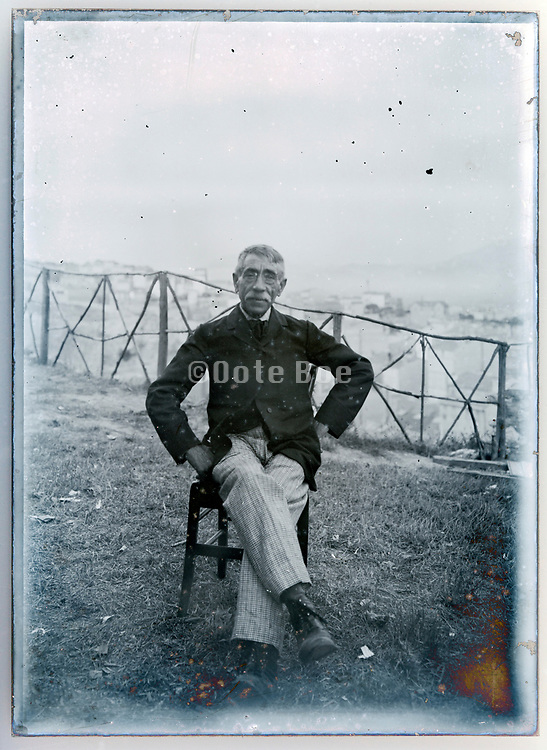 vintage portrait of man sitting by edge of a cliff