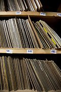 Shelves of vinyl records in cardboard wrapping ready for dispatch in a warehouse. The Vinyl Factory is the old EMI vinyl works in Uxbridge, Middlesex, producing limited edition vinyls of new releases, plus re-presses of classics. They also act as a distributor of vinyl releases.