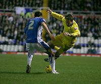 Leeds attacker Eddie Lewis (right) takes on Birmingham defender Stephen Kelly (left) again