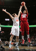 CHARLOTTESVILLE, VA- December 1: Sasha Chaplin #22 of the Indiana Hoosiers shoots over Chelsea Shine #50 of the Virginia Cavaliers during the game on December 1, 2011 at the John Paul Jones Arena in Charlottesville, Virginia. Virginia defeated Indiana 65-49. (Photo by Andrew Shurtleff/Getty Images) *** Local Caption *** Chelsea Shine;Sasha Chaplin