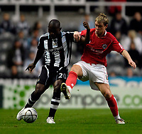Photo: Jed Wee/Sportsbeat Images.<br /> Newcastle United v Barnsley. Carling Cup. 29/08/2007.<br /> <br /> Newcastle's Geremi (L) holds off Barnsley's Grant McCann.