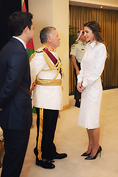 Jordan's Queen Rania Al Abdullah talks to King Abdullah II after he delivered a speech for the inauguration or the third ordinary session of the 18th Parliament, in Amman, Jordan, on October 14, 2018. Photo by Balkis Press/ABACAPRESS.COM