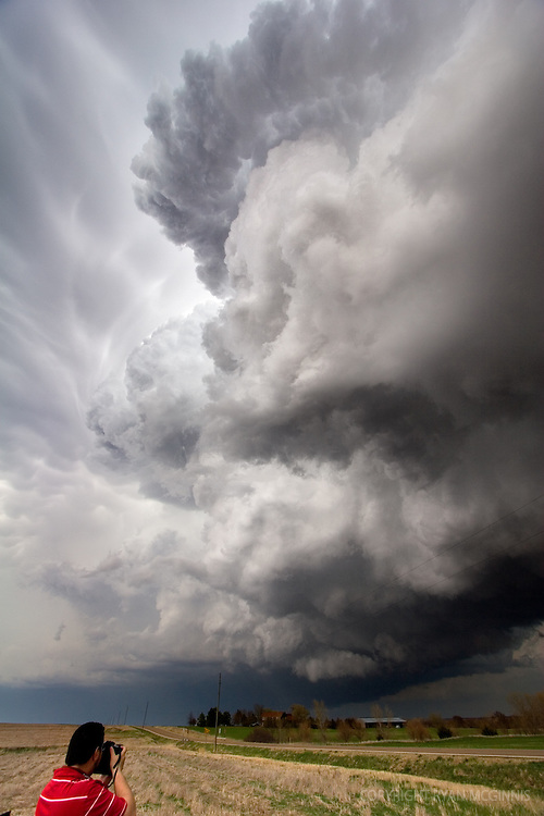 Photographer Josh Fiedler photographs a supercell in Kansas, April 6, 2006.  The supercell later produced a tornado.