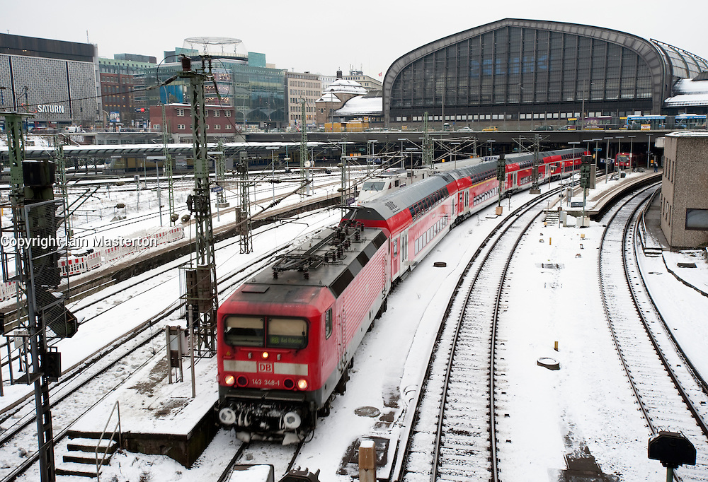 Train leaving Hamburg Hauptbahnhof railway station in Germany during winter