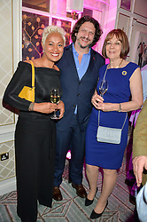 Left to right, MONICA GALETTI, JAY RAYNER and ? at the 2016 Fortnum & Mason Food & Drink Awards held at Fortnum & Mason, Piccadilly, London on 12th May 2016.
