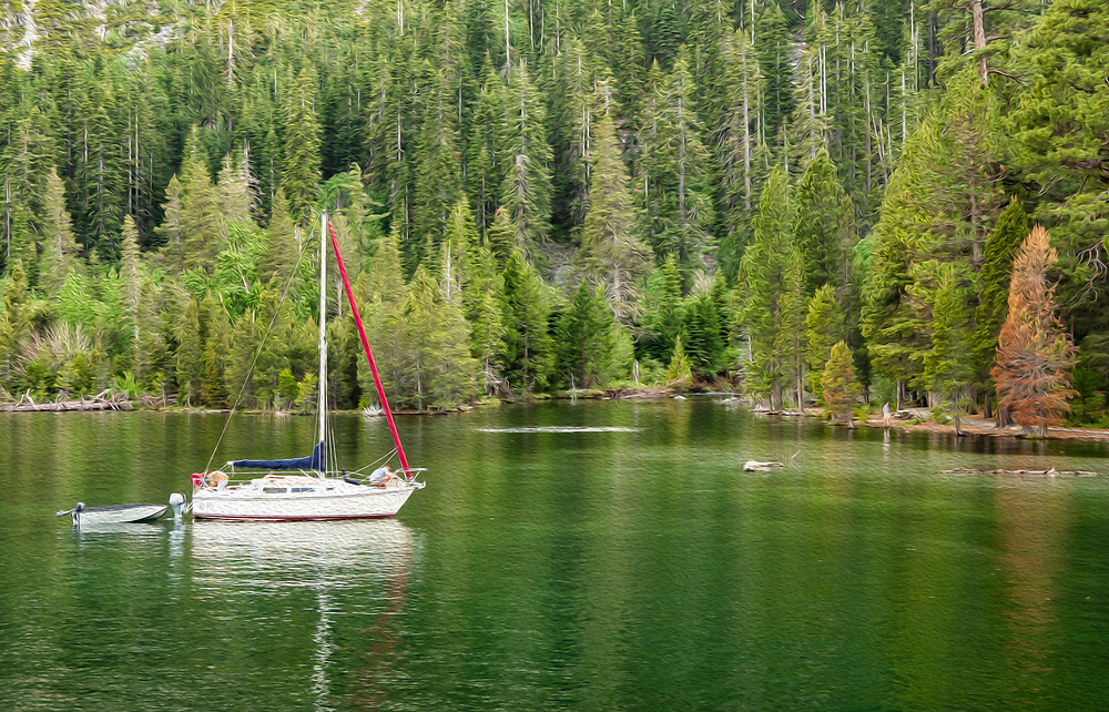 Sailboat anchored in Emerald Bay in South Lake Tahoe in California. Spring. Evening.