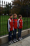 "Aristide Dubreu, from left, Nathan Dumortier and Pierre-Charles Bonnet, all 11 and visiting from Lille, France, stand in front of the White House to have their photo taken on Nov. 7, 2012 in Washington, D.C. ""For Europe it's very good,"" said Christelle Dumortier of President Barack Obama's win of the 2012 election. ""We were waiting for his victory."" The group spent Wednesday in Washington, D.C. during their trip to the United States."