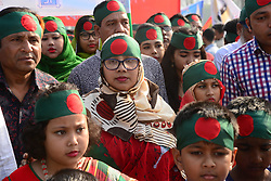 March 26, 2019 - Dhaka, Bangladesh - Bangladeshi people gather with flags and flowers to show their respect during the celebration of the country's Independence Day at the National Martyrs Memorial of the 1971 Bangladesh independence war's martyrs in Savar district near Dhaka, Bangladesh, on 26 March 2018. Bangladeshi celebrated the 48th anniversary of its bloody 1971 independence war against Pakistan and remembered the estimated three million people killed during the war of independence. (Credit Image: © Str/NurPhoto via ZUMA Press)