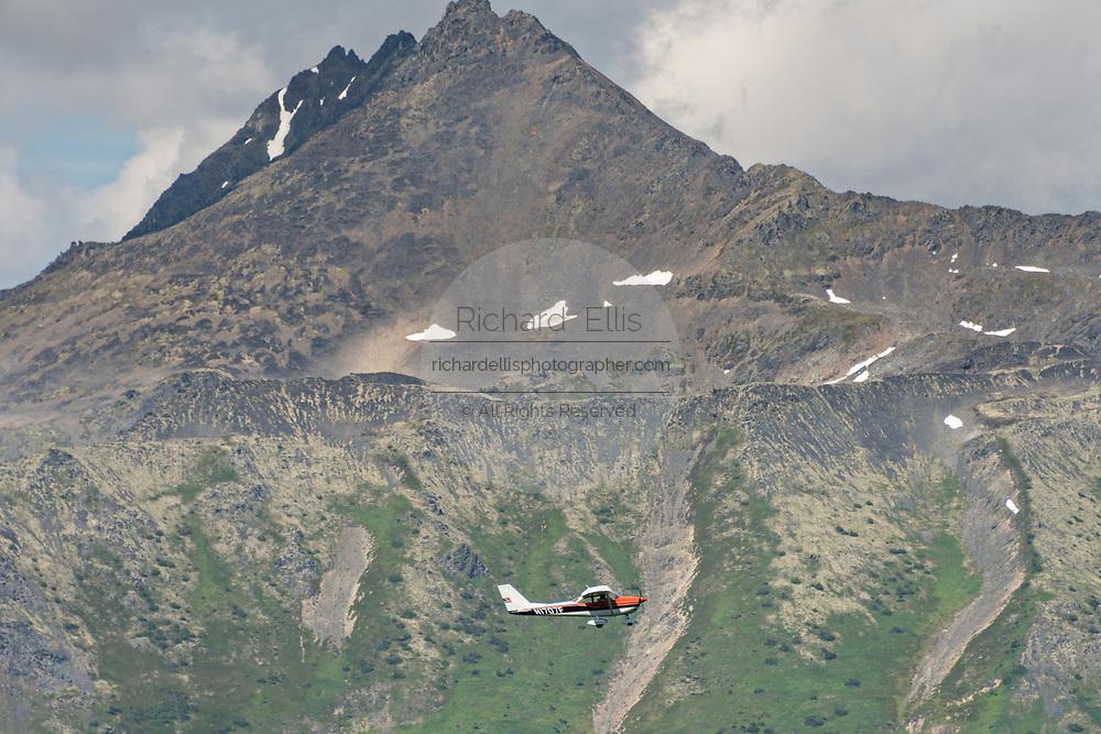 A flight seeing airplane climbs up the Chugach Mountains in Girdwood, Alaska.