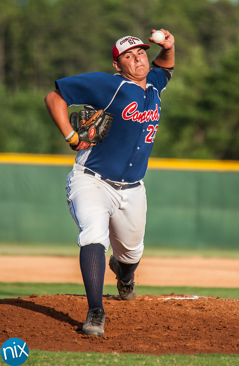Concord Post 51's Tyler Thomas pitches against Rowan County Tuesday night at Central Cabarrus High School. Concord won the game 7-6 in the second game of a best-of-five game playoff series.