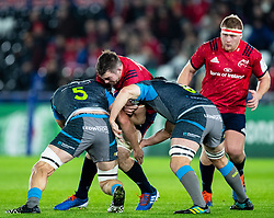 Billy Holland of Munster  under pressure from  Lloyd Ashley of Ospreys<br /> <br /> Photographer Simon King/Replay Images<br /> <br /> European Rugby Champions Cup Round 1 - Ospreys v Munster - Saturday 16th November 2019 - Liberty Stadium - Swansea<br /> <br /> World Copyright © Replay Images . All rights reserved. info@replayimages.co.uk - http://replayimages.co.uk