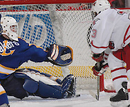 UNO's Scott Parse fires the game-winning goal past Lake Superior State goalie Jeff Jakaitis in overtime Saturday night in Qwest Center Omaha.