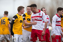 East Fife's Stevie Campbell and Stirling Albion's Scot Buist after was tackled East Fife's Kevin Smith and a small melee starts. <br /> East Fife 1 v 0 Stirling Albion, Scottish Football League Division Two game played atBayview Stadium, 20/2/2106.