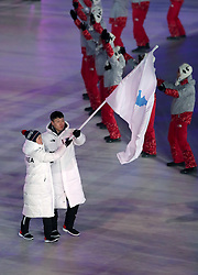 North and South Korea flag-bearers Chung Gum Hwang and Yunjong Won during the Opening Ceremony of the PyeongChang 2018 Winter Olympic Games at the PyeongChang Olympic Stadium in South Korea.