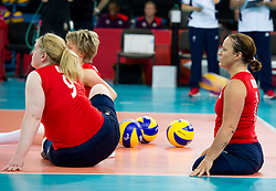 © Licensed to London News Pictures. 31/08/2012, The Paralympics women's sitting volleyball competition got under way this morning at the Excel Centre in London.   The team were beaten by the Ukrainian team who are currently ranked third in the world. Members of the team include Vice-captain Martine Wright (pictured right) who survived the 7/7 terrorist attacks in London and Sam Bowen an Iraqi war veteran.  Photo credit : Alison Baskerville/LNP