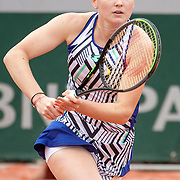 PARIS, FRANCE October 09. Polina Kudermetova of Russia in action against Alina Chareava of Russia in the Girls Singles Semi Finals of the singles competition on court thirteen during the French Open Tennis Tournament at Roland Garros on October 9th 2020 in Paris, France. (Photo by Tim Clayton/Corbis via Getty Images)