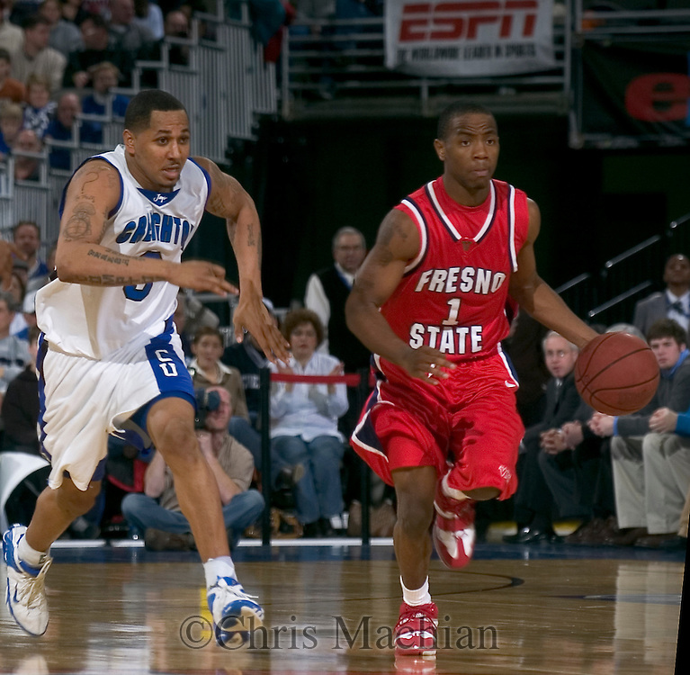 2/19/06  Omaha, Ne Creighton University's Nick Porter chases down Fresno State's  Kevin Bell  Saturday night at the Bracket Buster at Qwest Center Omaha..(Photo by Chris Machian/Prarie Pixel Group).