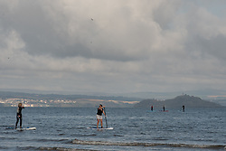 Plenty of room for social distancingon Portobello Beach this morning with a super low tide. I did mean the paddle boarders had a longer walk than usual down to the sea.<br /> <br /> <br /> © Jon Davey/ EEm