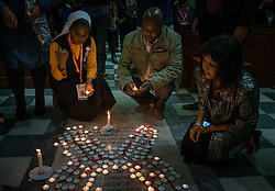 Participants light candles during a July 19 interfaith prayer service, held at the Roman Catholic Emmanuel Cathedral in Durban, South Africa, during the 2016 International AIDS Conference.