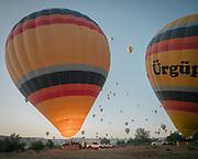Sunrise hot air balloon ride is a very popular way to appreciate the Cappadocia landscape.