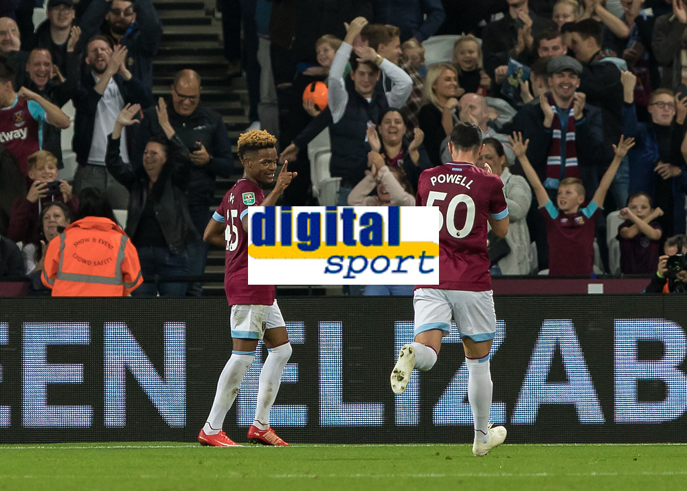 Football - 2018 / 2019 EFL Carabao Cup (League Cup) - Third Round: West Ham United vs. Macclesfield Town<br /> <br /> Grady Diangana (West Ham United) celebrates with fellow debutant Joe Powell (West Ham United) after he scores his second goal at The London Stadium<br /> <br /> COLORSPORT/DANIEL BEARHAM