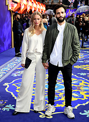 Marwan Kenzari (right) and guest attending the Aladdin European Premiere held at the Odeon Luxe Leicester Square, London.