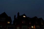 Residential home with lights on in the attic room at night in Kings Heath on 7th Febuary 2020 in Birmingham, United Kingdom.