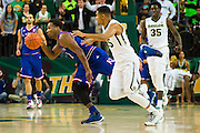 WACO, TX - JANUARY 7: Wayne Selden Jr. #1 of the Kansas Jayhawks steals the ball from Al Freeman #25 of the Baylor Bears on January 7, 2015 at the Ferrell Center in Waco, Texas.  (Photo by Cooper Neill/Getty Images) *** Local Caption *** Wayne Selden Jr.