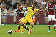 Mark Noble, the West Ham United captain is intercepted by Samir Masimov of NK Domzale. UEFA Europa league, 3rd qualifying round match, 2nd leg, West Ham Utd v NK Domzale at the London Stadium, Queen Elizabeth Olympic Park in London on Thursday 4th August 2016.<br /> pic by John Patrick Fletcher, Andrew Orchard sports photography.