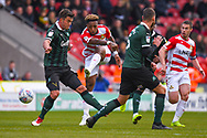 Mallik Wilks of Doncaster Rovers (7) shoots during the EFL Sky Bet League 1 match between Doncaster Rovers and Plymouth Argyle at the Keepmoat Stadium, Doncaster, England on 13 April 2019.