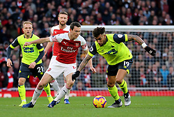 Huddersfield Town's Daniel Williams (right) and Arsenal's Stephan Lichtsteiner battle for the ball during the Premier League match at the Emirates Stadium, London.