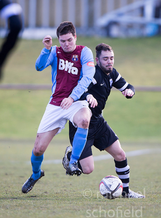 Whitehill Welfare Andy Martin and Edusport Academy Axel Bacquet.<br /> half time : Whitehill Welfare 1 v 1 Edusport Academy, South Challenge Cup Quarter Final played 7/3/2015 at Ferguson Park, Carnethie Street, Rosewell.