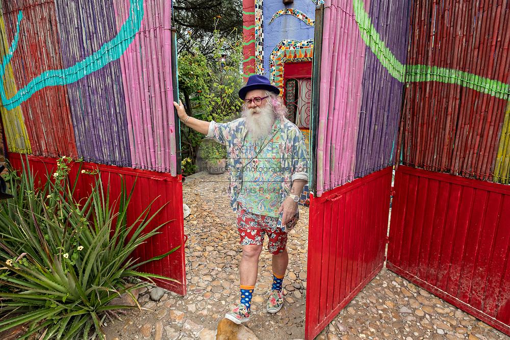 American artist Anado McLauchlin outside the Chapel of Jimmy Ray in his art compound Casa las Ranas September 28, 2017 in La Cieneguita, Mexico.