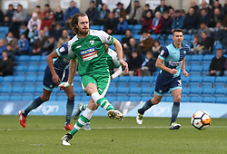 Leatherhead's Jack Midson scores the opening goal from the penalty spot during the Emirates FA Cup, second round match at Adams Park, Wycombe.