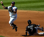 MORNING JOURNAL/DAVID RICHARD<br />Cleveland second baseman Ronnie Belliard leaps in the air to avoid a sliding Timo Perez of Chicago yesterday in the third inning. White Sox hitter Tadahito Iguchi was safe at first base on a fielder's choice.