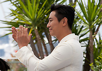 Actor Jung-min Hwang at the Gongjak (The Spy Gone North) film photo call at the 71st Cannes Film Festival, Friday 11th May 2018, Cannes, France. Photo credit: Doreen Kennedy