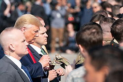 President Donald J. Trump arrives at Elmendorf  AFB for a refuel Wednesday June 26, 2019, in Alaska, en route Japan for the 2019 G20.  Also shown are the Governor of Alaska and US Troops.(Official White House Photo by Shealah Craighead)