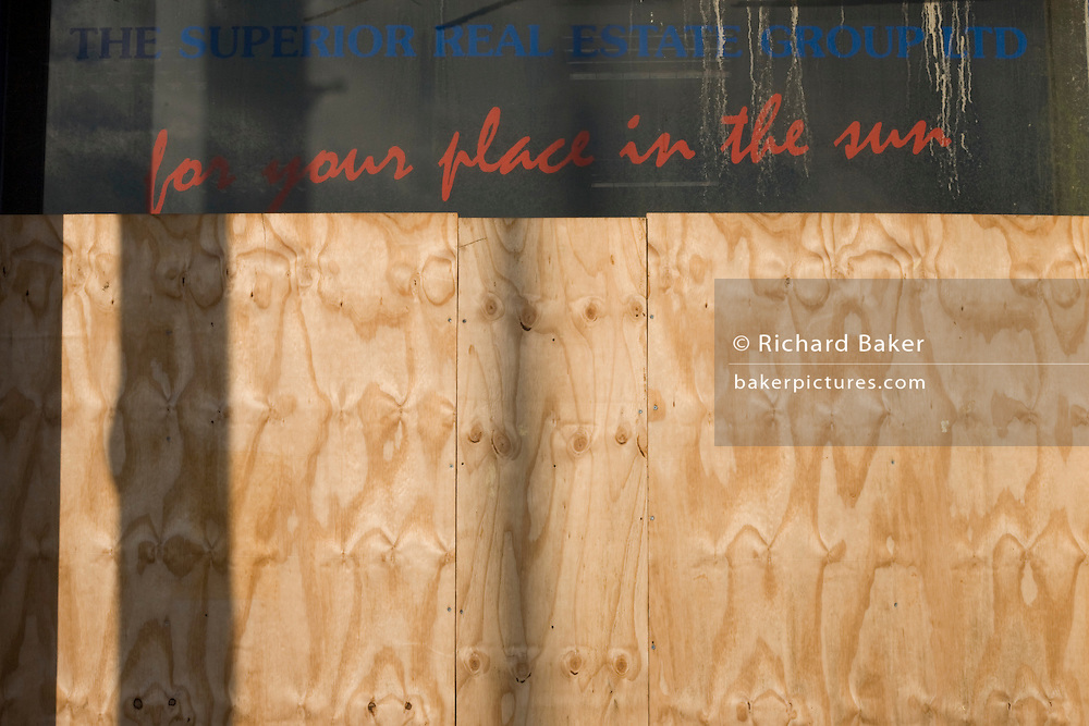 A boarded-up travel agent's business advertising For Your Place in the Sun seen in Bristol, a victim of the UK recession.