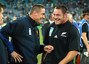 20 November 2003, Rugby Union World Cup, Telstra Stadium, Sydney, Australia. 3rd/4th Playoff, New Zealand vs France. <br />All Black replacement hooker Mark Hammett shares a joke with New Zealand born French centre Tony Marsh at the end of the match.  The All Blacks defeated France 40-13<br />Pic: Andrew Cornaga/Photosport