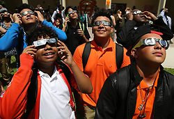 On the first day of school, students, teachers, and faculty members gaze toward the sky on Monday, Aug. 21, 2017 to witness the partial eclipse at Booker T. Washington Senior High School in Miami, Fla. Photo by Carl Juste/Miami Herald/TNS/ABACAPRESS.COM