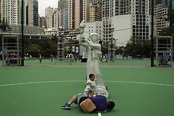 June 4, 2017 - Hong Kong, CHINA - A father snapping pictures of his son under the mock-up GODDESS OF DEMOCRACY, a symbol  of Chinas democratic movement of 1989 at the Victoria Park, Hong Kong. Today mark 28th anniversary of the June 4th Massacre, Hong Kongers are preparing for annual Candle Light Vigil this evening at Victoria Park organized by HONG KONG ALLIANCE IN SUPPORT OF PATRIOTIC DEMOCRATIC MOVEMENTS OF CHINA. June 4, 2017.Hong Kong.ZUMA/Liau Chung Ren (Credit Image: © Liau Chung Ren via ZUMA Wire)