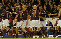Photo: Leigh Quinnell.<br /> Arsenal v Fulham. The Barclays Premiership.<br /> 24/08/2005. Arsenal players celebrate with Pascal Cygan after his goal.