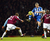 Photo: Chris Ratcliffe.<br />West Ham United v Wigan Athletic. The Barclays Premiership. 28/12/2005.<br />Graham Kavanagh (R) gets to the ball before David Bellion of West Ham.