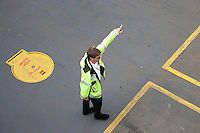 A Washington State Ferry worker directs auto traffic while loading a ferry in Bremerton in Puget Sound, WA, USA