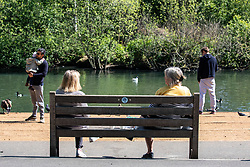 © Licensed to London News Pictures. 12/05/2020. London, UK. Members of the Public enjoy the sunshine on Barnes Ponds South West London as the Government is set to relax the law on lockdown tomorrow (Wednesday 13 May 2020) to let people spend more time outside to enjoy the fresh air, picnics, sunbathing and to be able meet other people while following social distancing guidelines. Photo credit: Alex Lentati/LNP