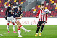 Middlesbrough midfielder Lewis Wing (8) shoots during the EFL Sky Bet Championship match between Brentford and Middlesbrough at Brentford Community Stadium, Brentford, England on 7 November 2020.