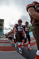 KELOWNA, BC - AUGUST 17:  Kaden Wagner #87 and Farrell Kenfack #82 of Okanagan Sun walk to the field against the Westshore Rebels at the Apple Bowl on August 17, 2019 in Kelowna, Canada. (Photo by Marissa Baecker/Shoot the Breeze)