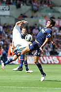 Swansea city's Leon Britton (l) battles for the ball with James Tomkins of West Ham ®. Barclays Premier league, Swansea city  v West Ham Utd at the Liberty Stadium in Swansea, South Wales  on Saturday 25th August 2012. pic by Andrew Orchard, Andrew Orchard sports photography,