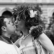 MILAN, ITALY - JUNE 12:  Two participants to the Gay Pride Milano dressed as a cardinal and as a bride kiss before the start of the march on June 12, 2010 in Milan, Italy.  Pride Milano is one of the oldest gay marches in Italy and today's march is against homophobic violence  (Photo by Marco Secchi/Getty Images)