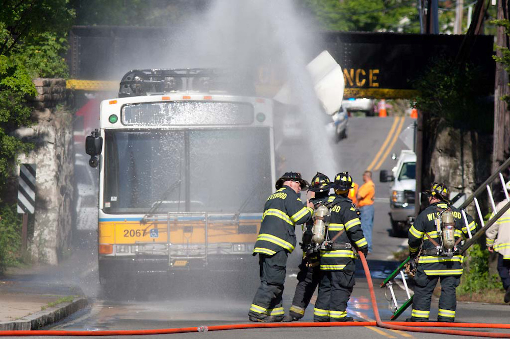 Westwood, MA 05/19/2012<br /> Firefighters hose down an MBTA bus after it collided with a railroad bridge on East St. in Westwood on Saturday afternoon.